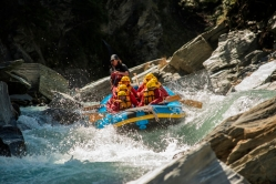 Challenge Rafting Group Hitting The Shotover River Rapids.