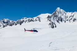 A Helicopter Line Heli Flying Over a Glacier.